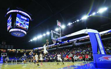 Ghared Boyce sails through the air for two points during Everett's dominating fourth-quarter performance vs. Lawrence.